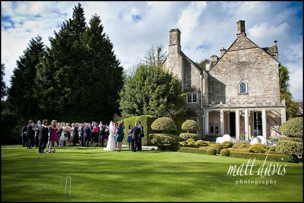 Wedding guests at Barnsley House, Cirencester