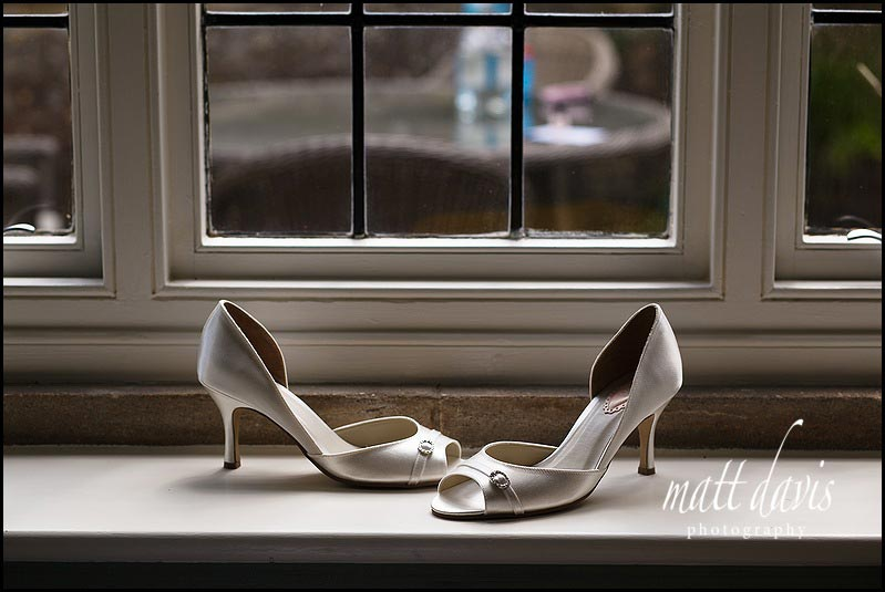 Wedding shoes on window sil