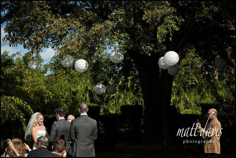 Barnsley House outdoor wedding ceremony with lanterns