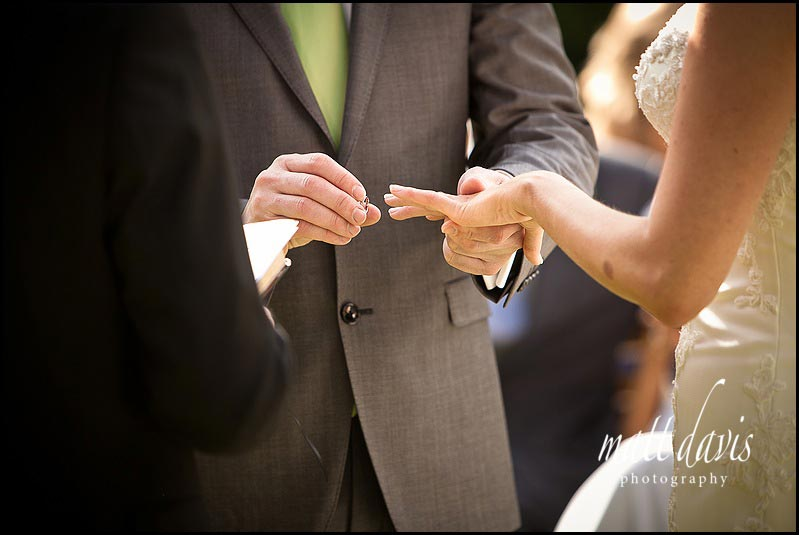 Ring exchange at Barnsley House outdoor ceremony