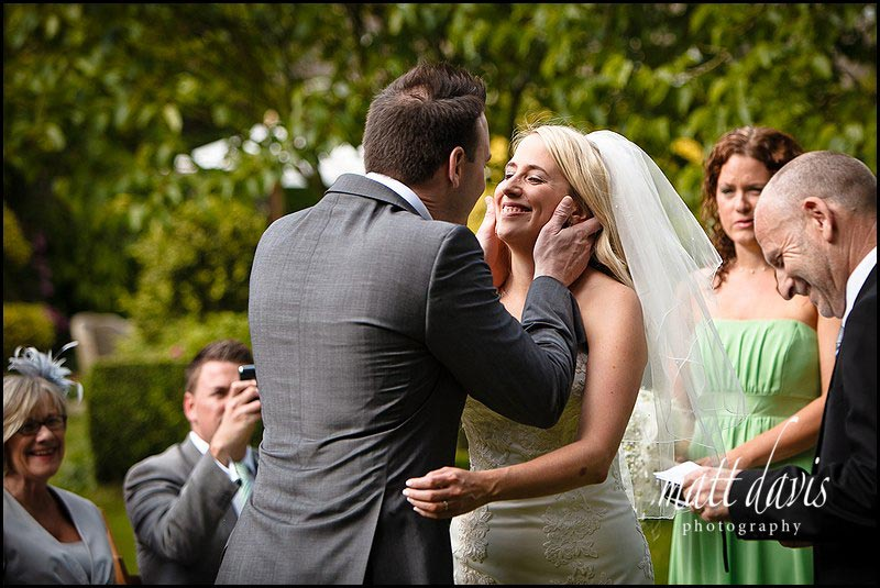 Bride about to kiss groom at Bansley House