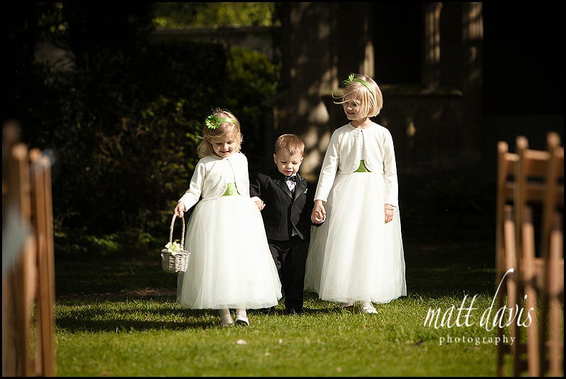 Flower girls at Barnsley House walking down the aisle