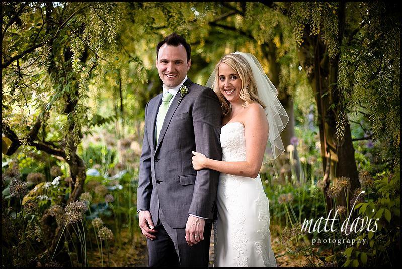 Barnsley House wedding photography in Laburnum arch