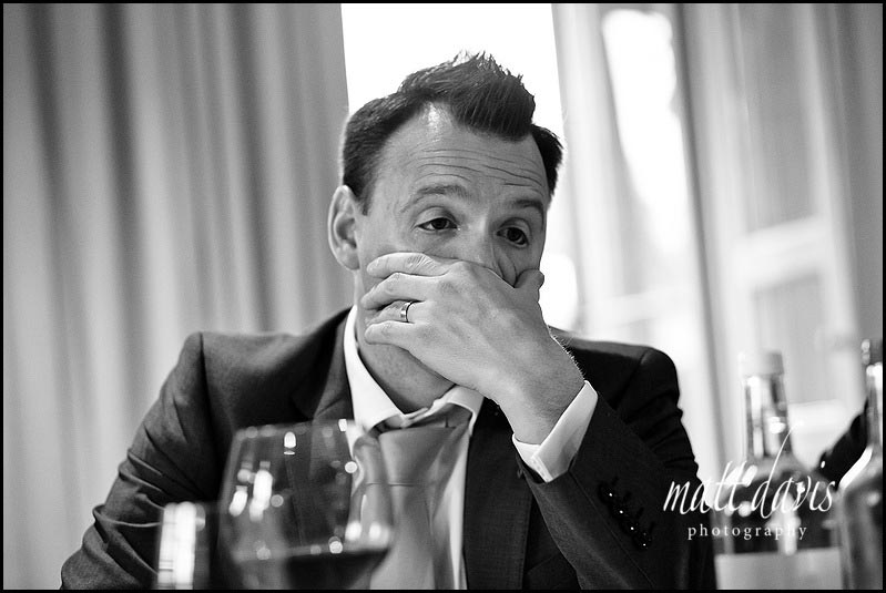 Barnsley House wedding photography of groom pulling a funny face