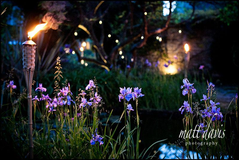 Barnsley House gardens lit with wedding torches