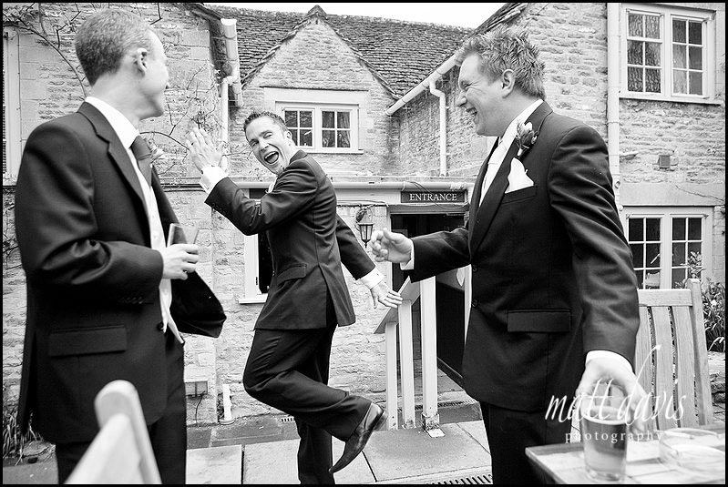 Groom and best man before wedding in pub