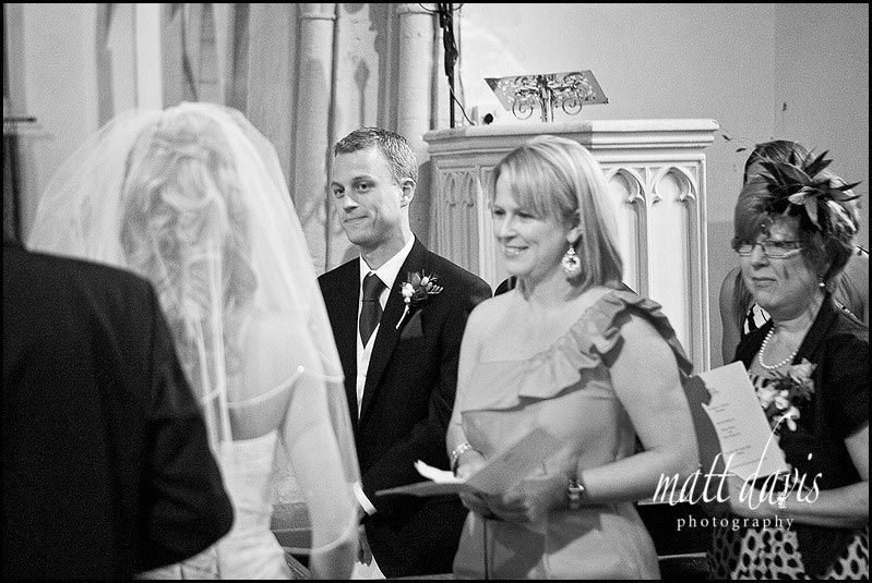 Groom looking at Bride in Barnsley Church
