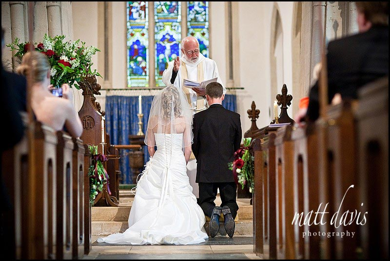 Bride and groom praying at Barnsley Church