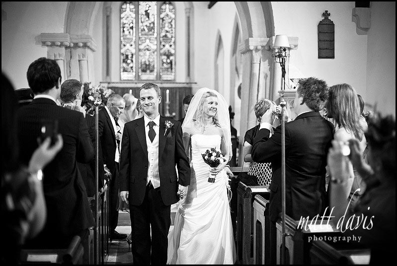 Bride and groom leaving Barnsley Church