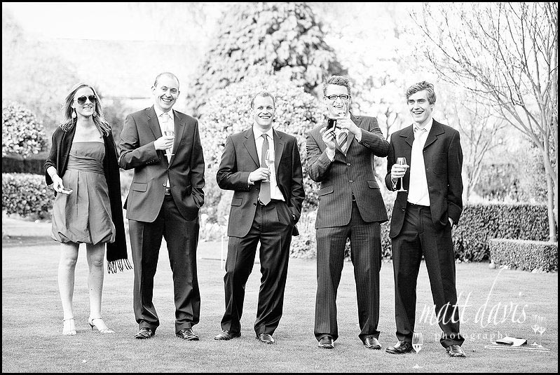 Wedding guests taking photos at Barnsley House wedding