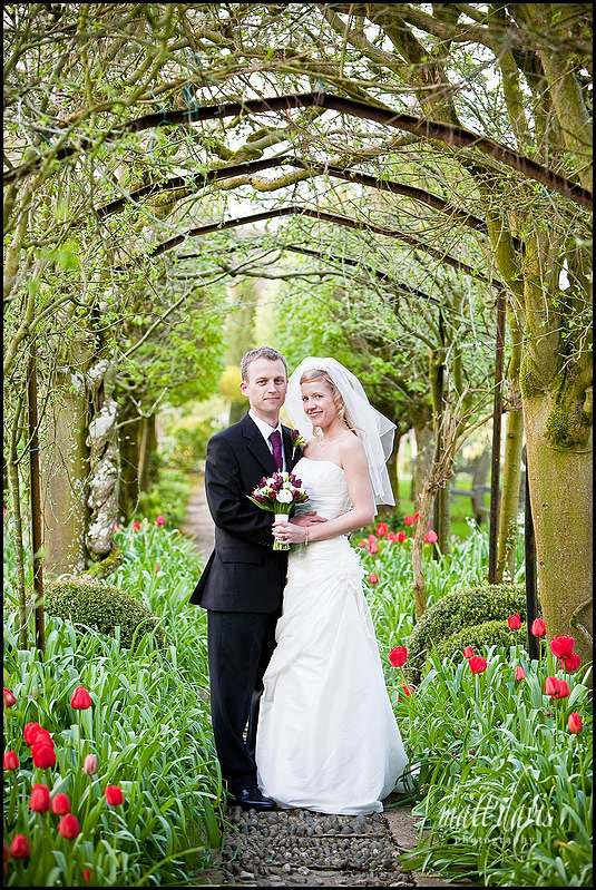 Barnsley House wedding photos in Laburnum arch