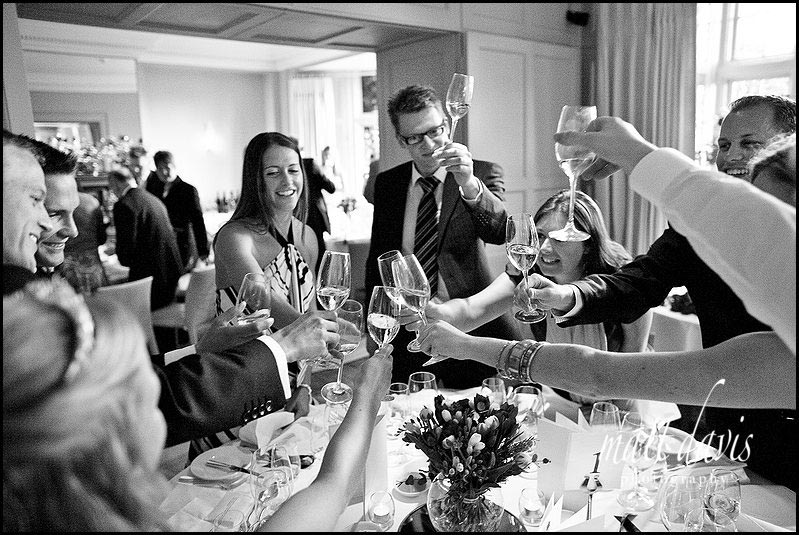 Raising a glass during wedding speeches at Barnsley House