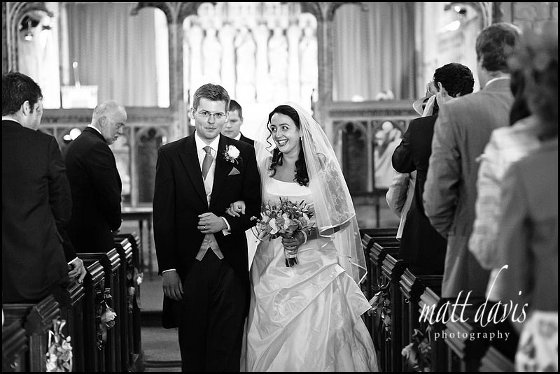 Bride and groom leaving church for Berkeley Castle