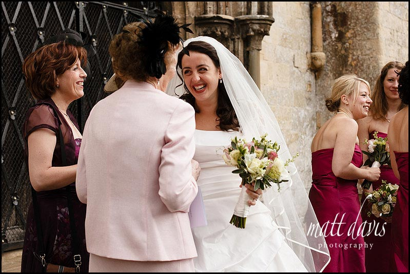Bride smiling with wedding guests