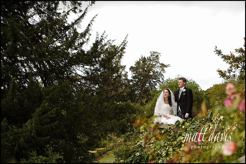 Garden photos of wedding couple at Berkeley Castle