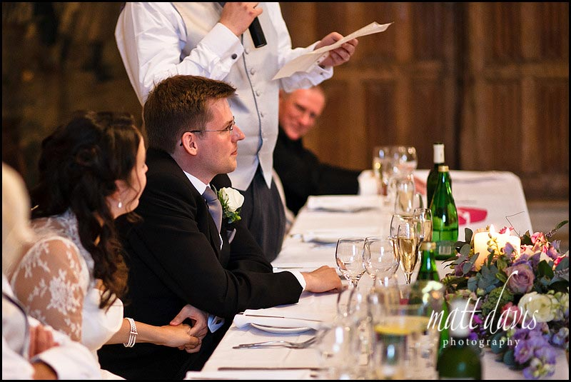 Holding hands during wedding speeches held at Berkeley Castle
