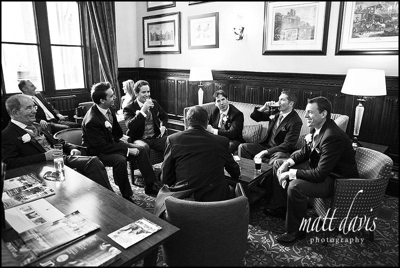 Groom and ushers having a pint before the wedding