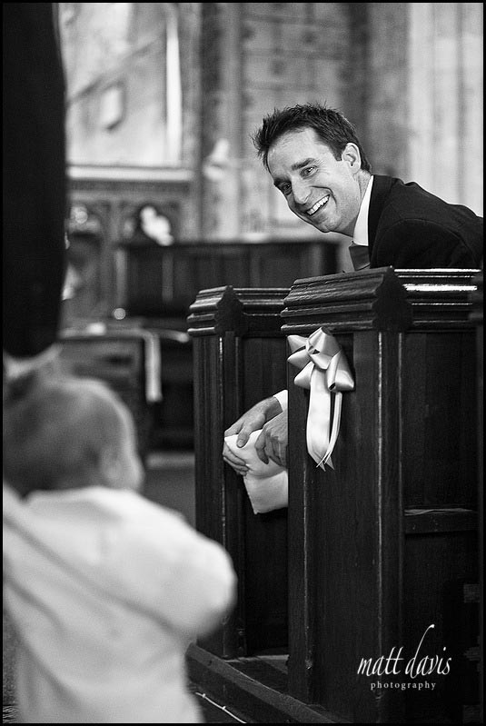 Groom smiling inside Berkeley Church