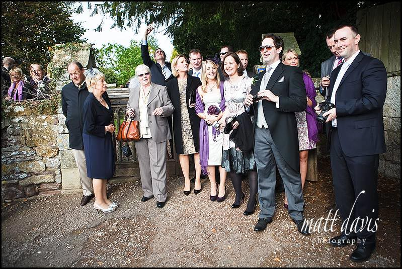 Wedding guests at Berkeley Castle waving