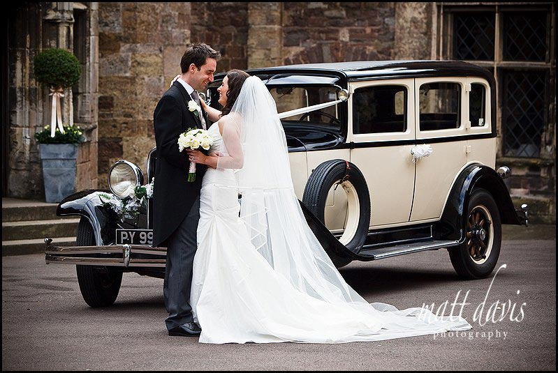 Berkeley Castle wedding photo of vintage car and wedding couple