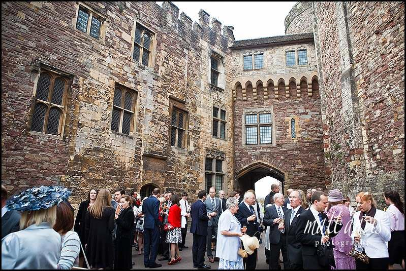 Wedding guests in the courtyard at Berkeley Castle