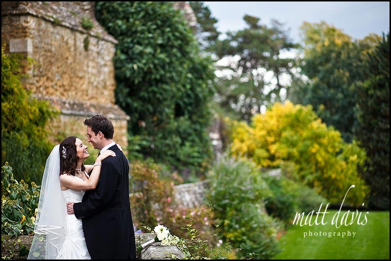 Bride and groom on terraces at Berkeley castle