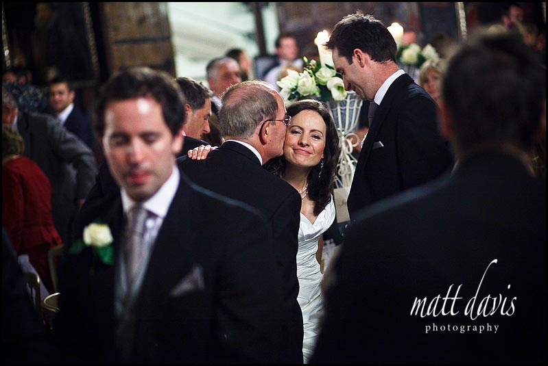 Father of bride kissing her after his speech