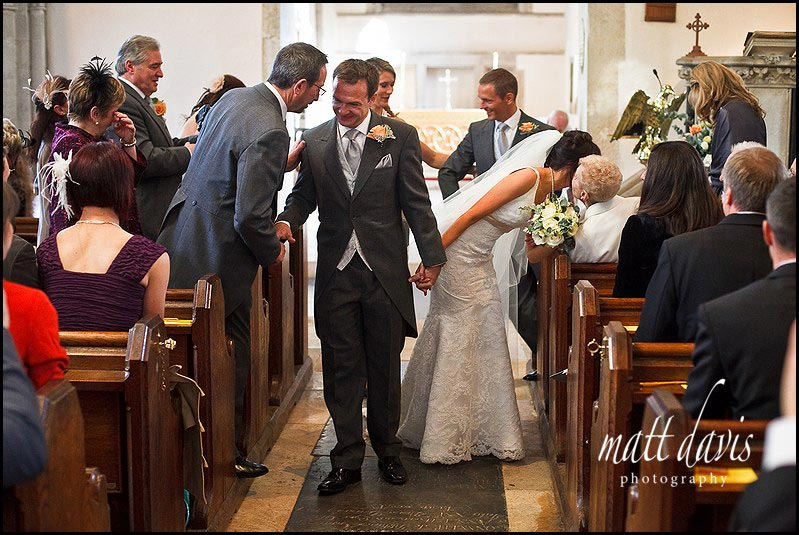 Bibury Church wedding photos in aisle