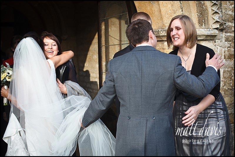wedding guests at Bibury Church