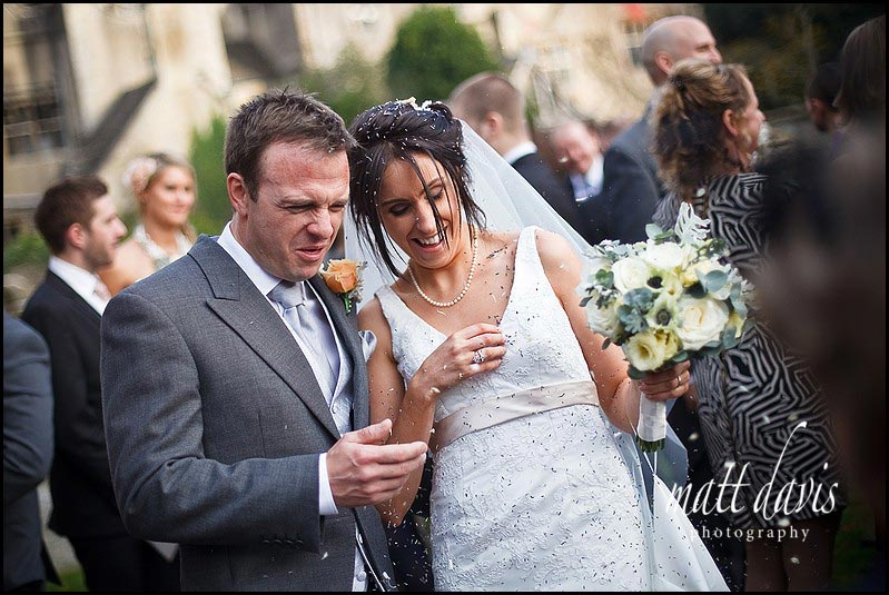 wedding photos of confetti at Bibury Church