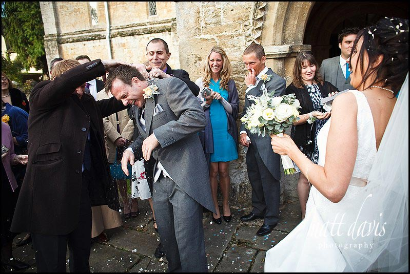 Groom with confetti in jacket