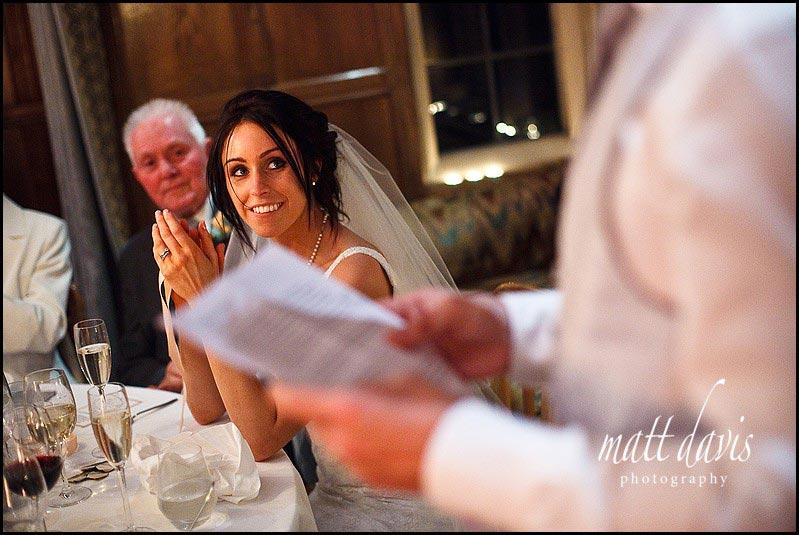 bride smiling during Speeches at Bibury Court