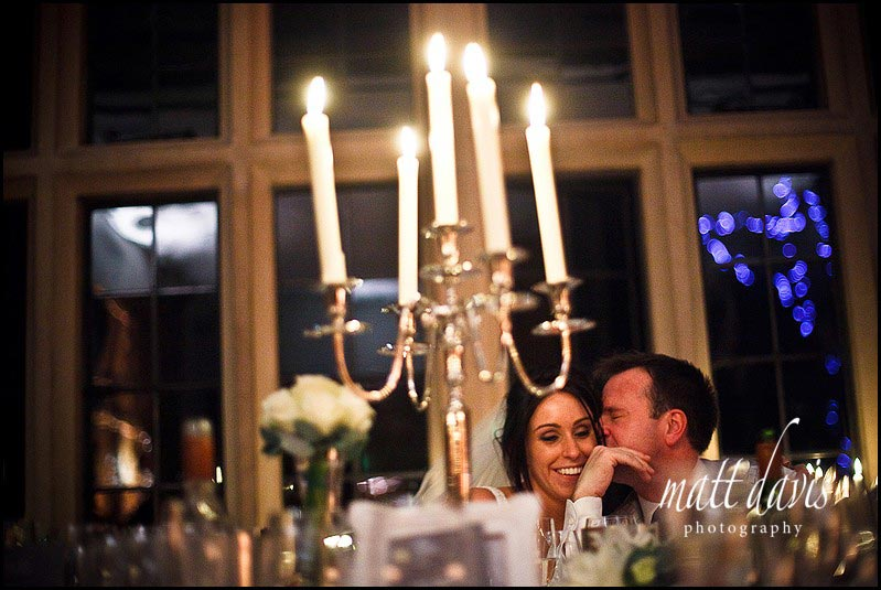 Wedding couple kiss by candle light
