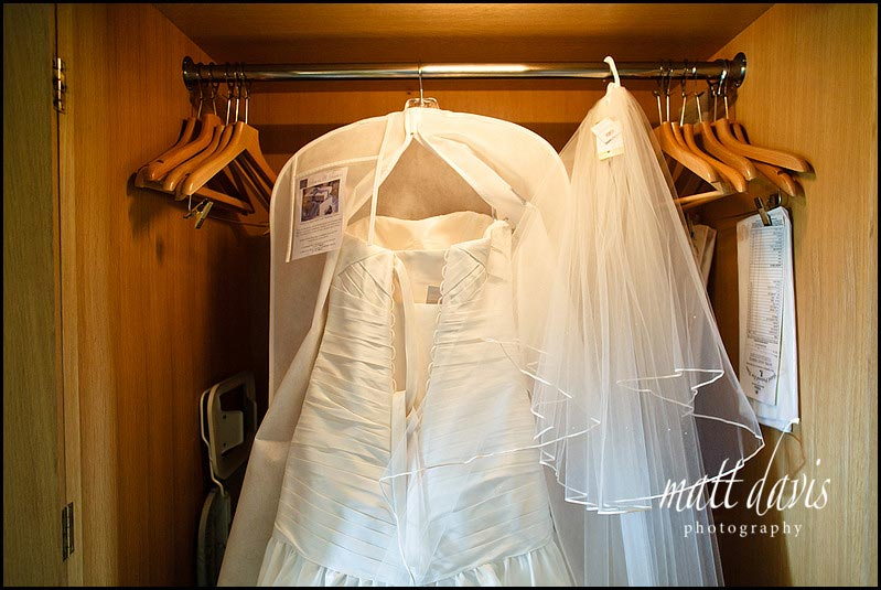 wedding dress hung in wardrobe