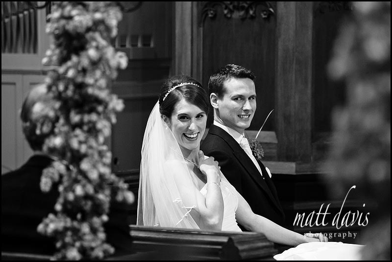 Birtsmorton Church bride and groom laughing