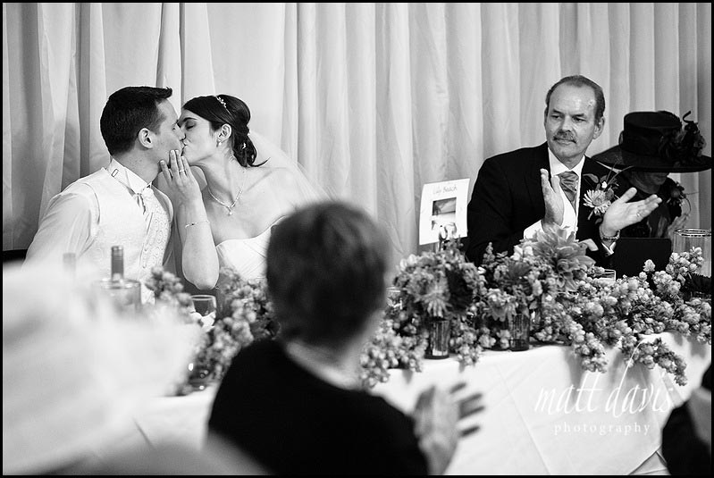 bride kisses groom during wedding speeches at Birtsmorton Court