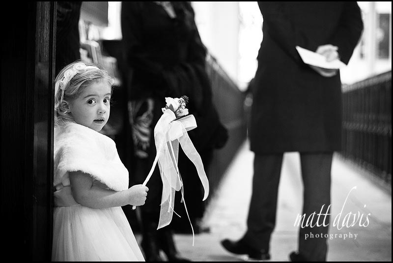 Bridesmaid at winter wedding in Tetbury church