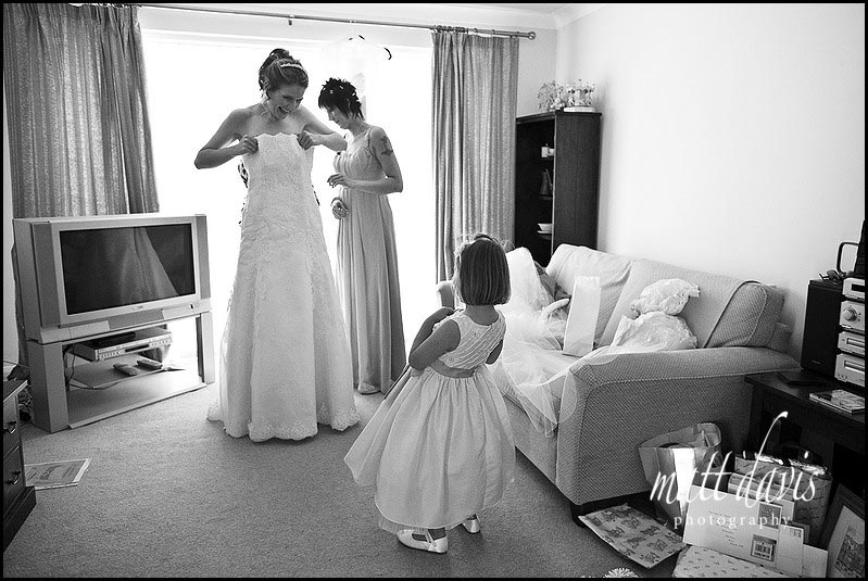 bride putting wedding dress on