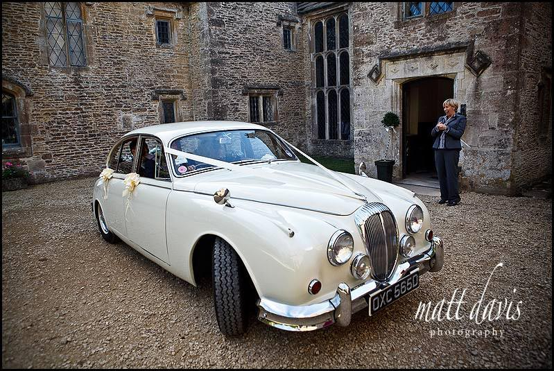Vintage wedding car at Chavenage House wedding