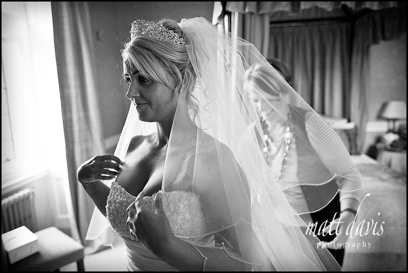 Bride with veil at Clearwell castle wedding