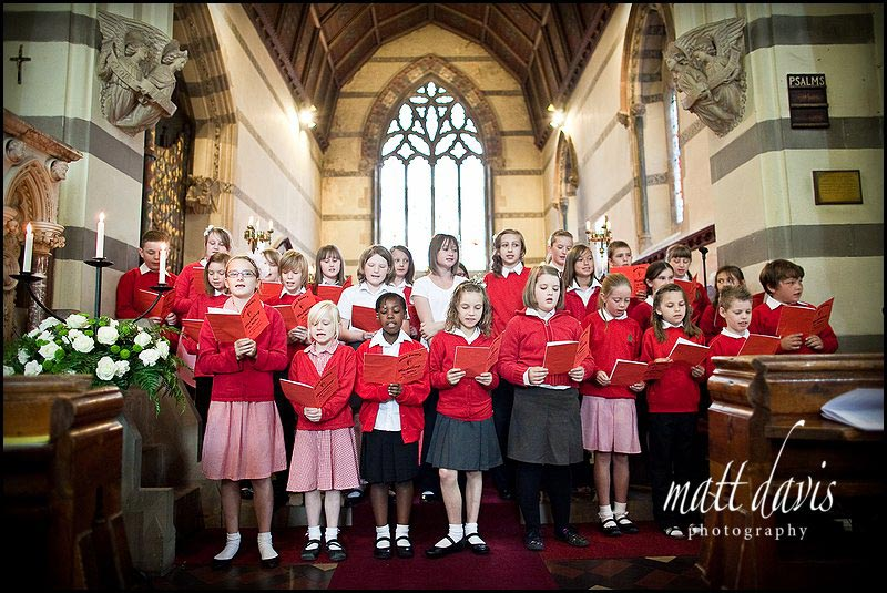 A class of school children singing at a wedding in St. Peter's Church Clearwell