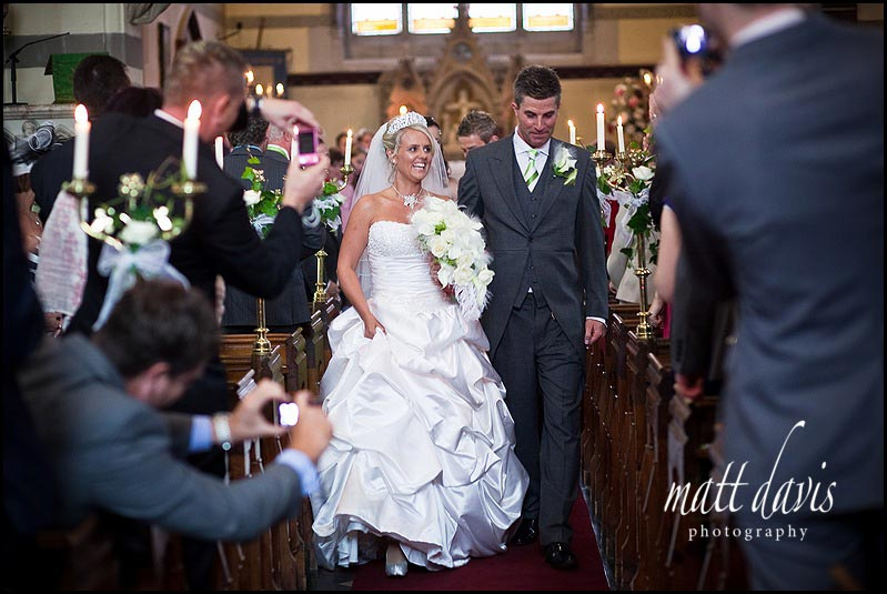 bride walking down the aisle at St. Peter's Church