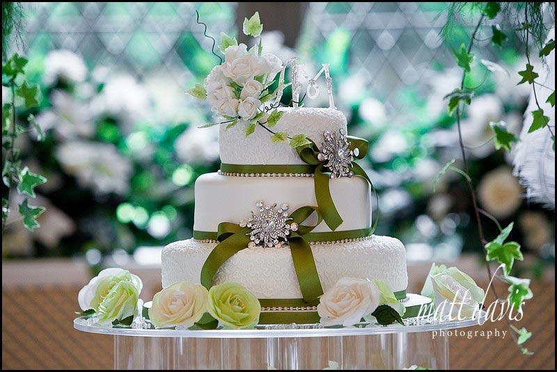 wedding cake with green ribbon