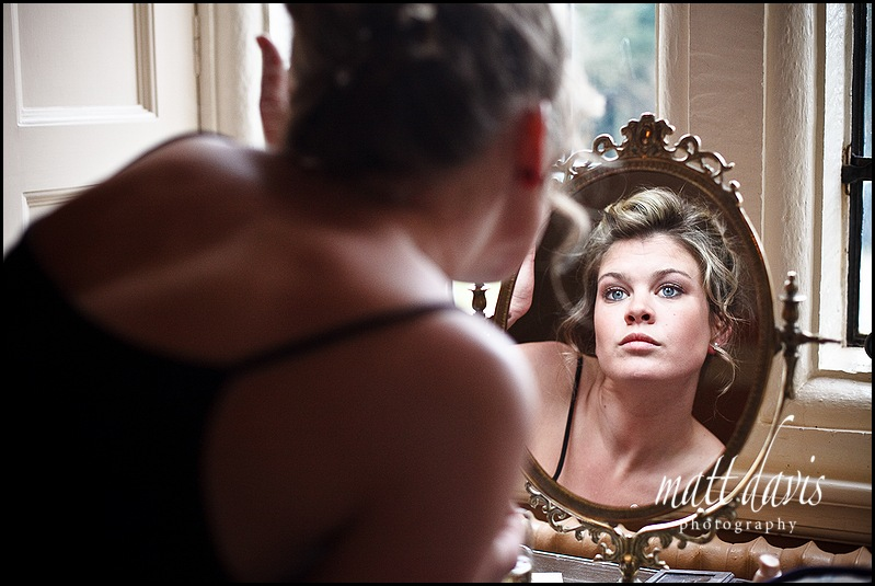 Wedding make-up in mirror at Clearwell Castle
