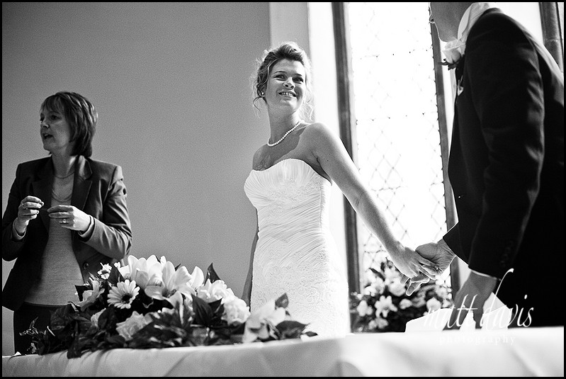 Bride smiling at groom at Clearwell Castle