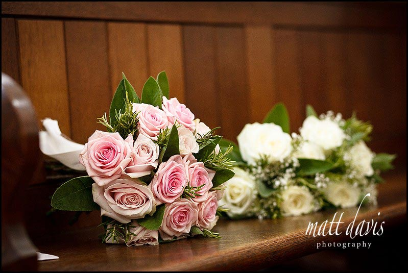 Wedding flowers on church pew