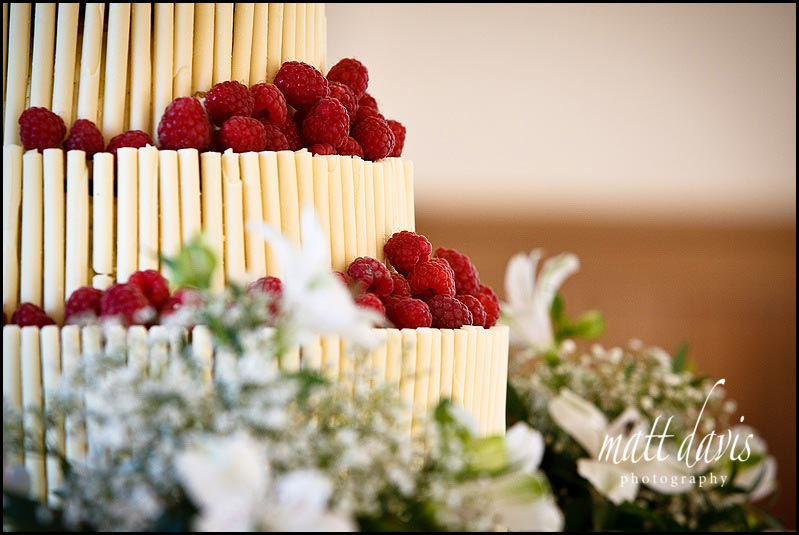 White chocolate wedding cake with raspberries
