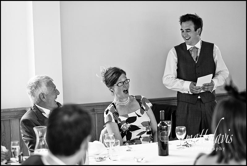 Shocked mother of the bride during wedding speeches at Delbury Hall