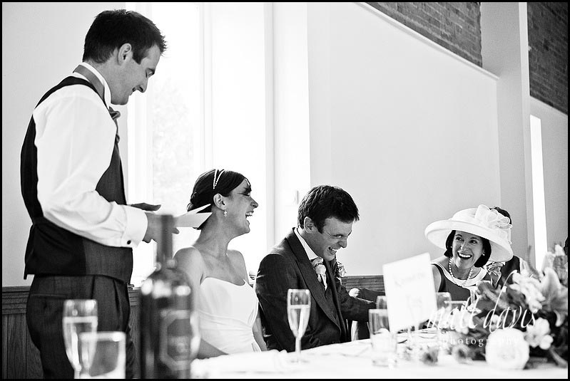 Laughing mother of the groom during wedding speeches at Delbury Hall