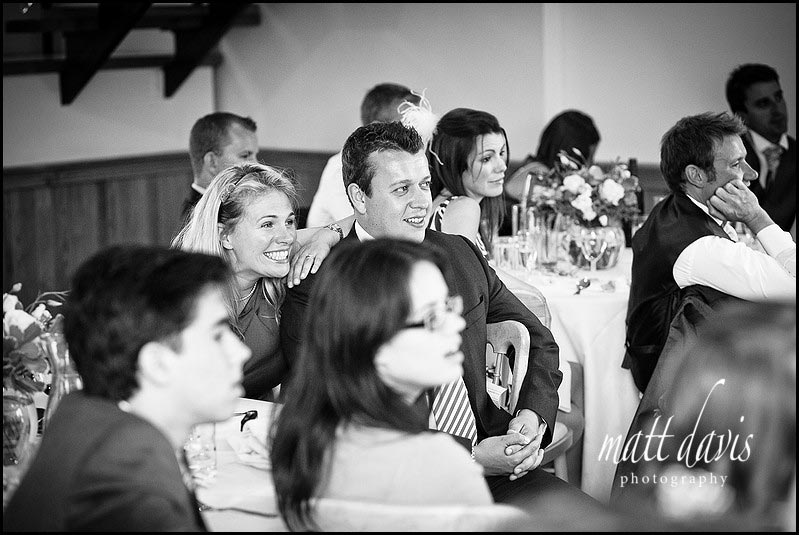 Wedding guests expressions during wedding speeches at Delbury Hall